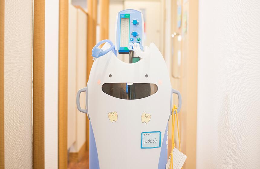 治療への不安を抑えるための「笑気吸入鎮静器」